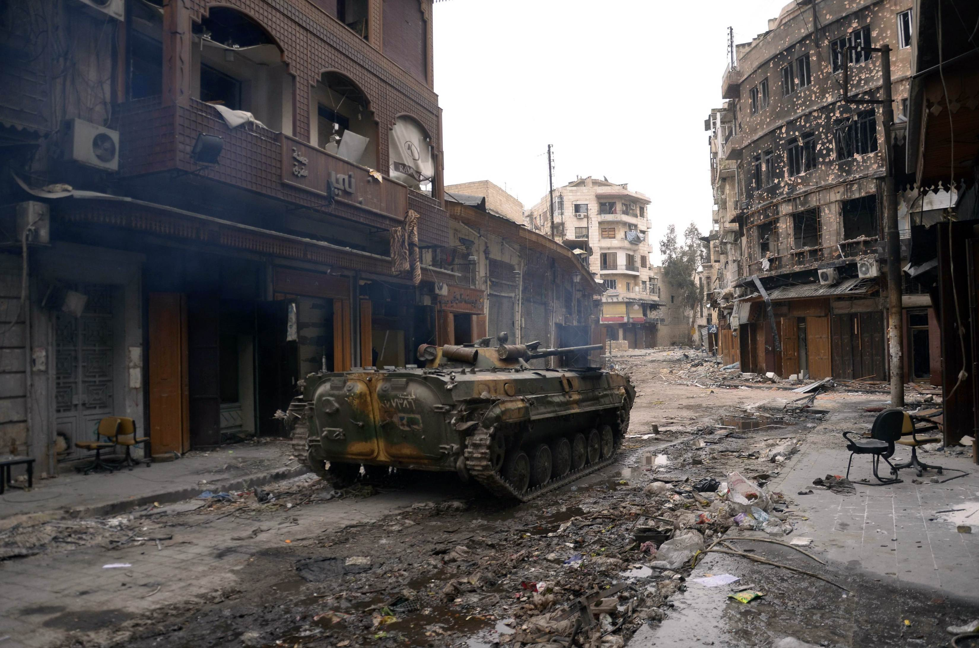 A military vehicle belonging to Syrian army loyal to President Bashar al-Assad is seen in Khan al-Wazir district near the castle of  Aleppo January 12, 2013.  REUTERS/George Ourfalian      (SYRIA - Tags: CIVIL UNREST POLITICS MILITARY)